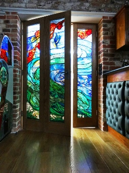 stained glass entrance windows by glass artist designer maker Jude Tarrant